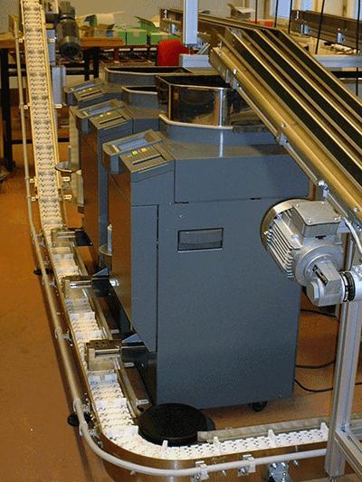Transport de monnaie avec le convoyeur à bande FlexLink type 45