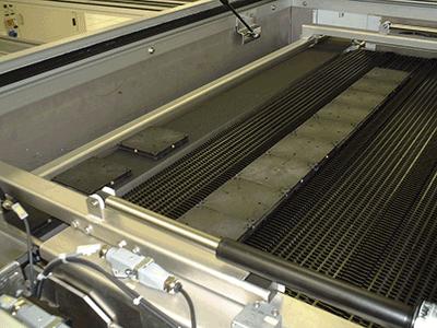 Transport de palettes dans un four de process